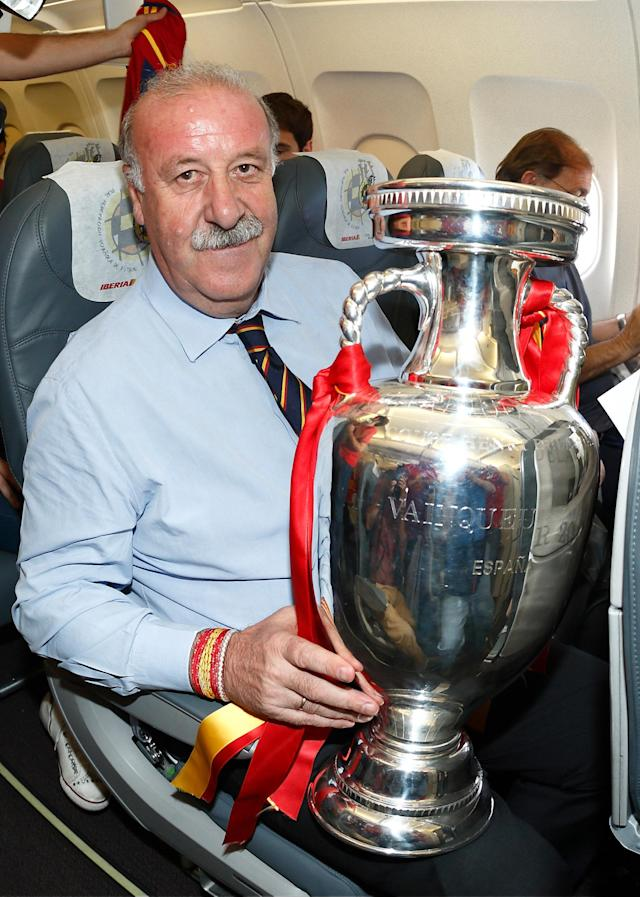 IN FLIGHT - JULY 02: In this handout image supplied by the Royal Spanish Football Federation, Head Coach Vicente del Bosque of Spain poses with the trophy following his team's victory in the UEFA EURO 2012 final match against Italy onboard the Spain team's airplane during their flight back to Madrid on July 2, 2012 in flight. (Photo by Carmelo Rubio Sanchez/RFEF via Getty Images)