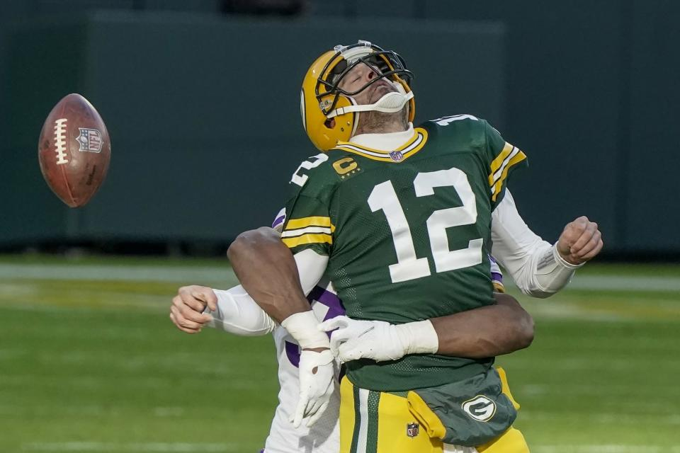 Green Bay Packers' Aaron Rodgers fumbles the ball as he is hit by Minnesota Vikings' D.J. Wonnum during the second half of an NFL football game Sunday, Nov. 1, 2020, in Green Bay, Wis. (AP Photo/Morry Gash)