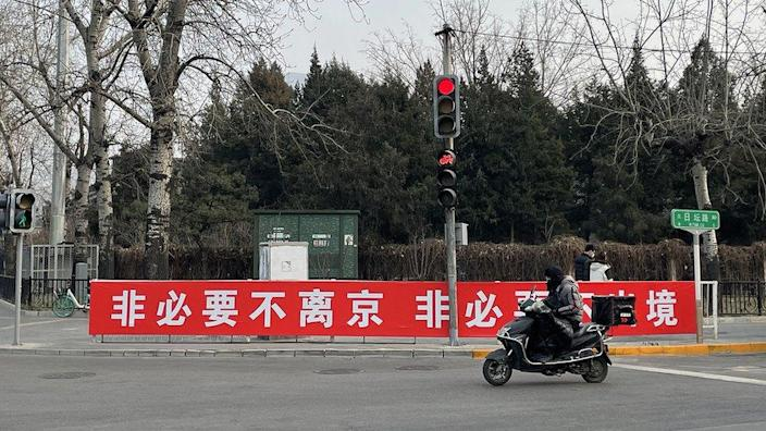 """""""Don't leave Beijing unless necessary. Don't go abroad unless necessary."""""""