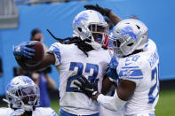 Detroit Lions cornerback Desmond Trufant celebrates with strong safety Duron Harmon, right, after an interception in the end zone during the second half of an NFL football game against the Carolina Panthers Sunday, Nov. 22, 2020, in Charlotte, N.C. (AP Photo/Gerry Broome)