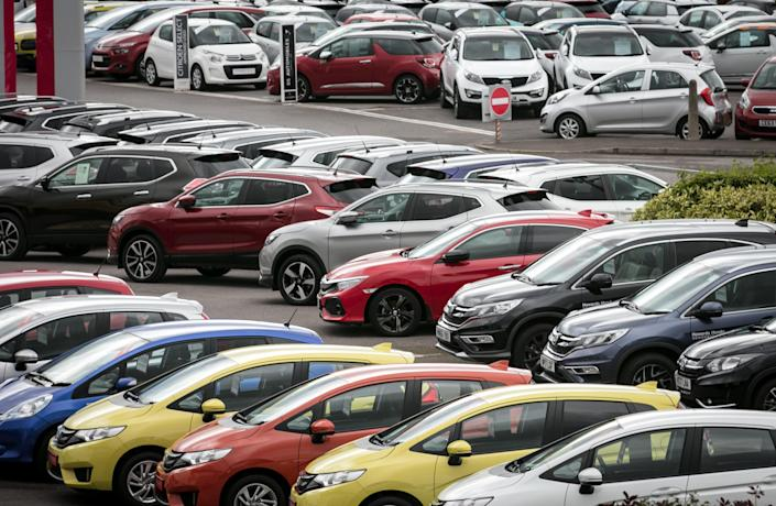 New and nearly new cars are displayed for sale on a forecourt of a car dealership. (Matt Cardy/Getty Images)