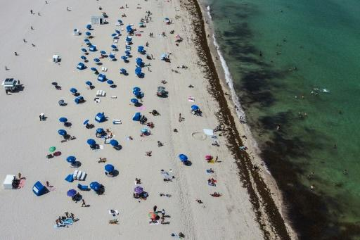 People hit the sand in Miami Beach on June 10