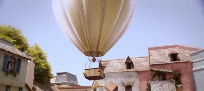 A hot-air balloon floating into the sky