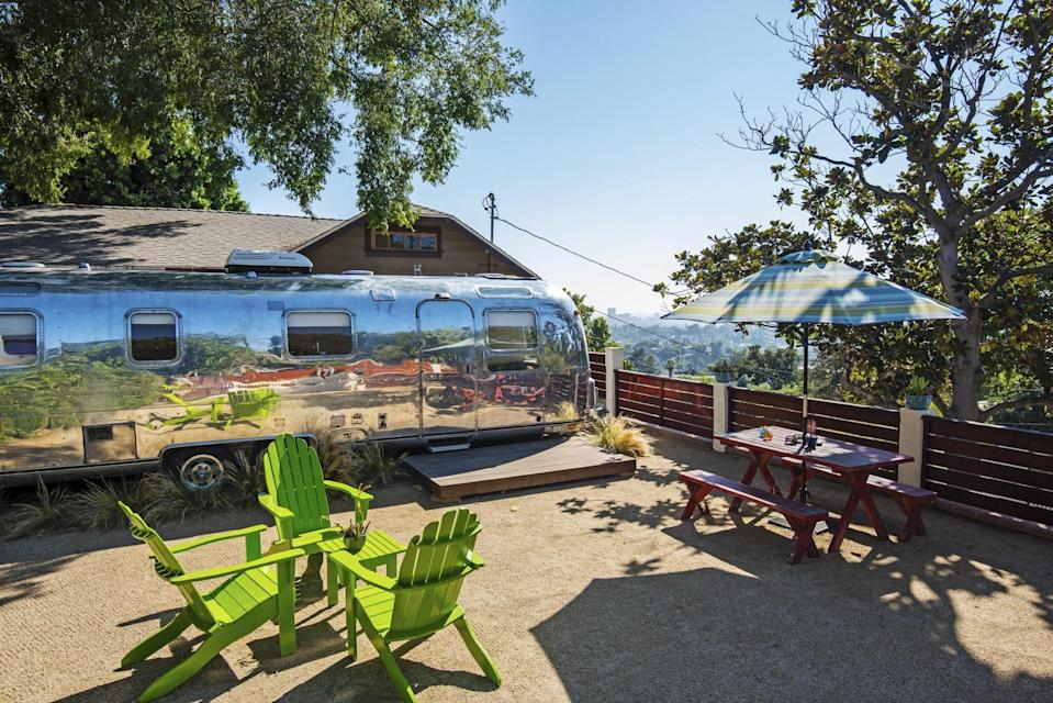"""<p>Permanently parked in <a href=""""https://www.cntraveler.com/destinations/los-angeles?mbid=synd_yahoo_rss"""" rel=""""nofollow noopener"""" target=""""_blank"""" data-ylk=""""slk:L.A.'s Echo Park"""" class=""""link rapid-noclick-resp"""">L.A.'s Echo Park</a> neighborhood, this Airbnb Plus Airstream has spectacular views over the sprawling city from its yard, which serves as additional outdoor living space for the trailer. Inside, the bright white interior reflects the California sun, filling the kitchen, living room, and queen-sized bedroom with natural light. The kitchen is well-equipped, with a gas stove so you can do more than just re-heating take out if you're feeling adventurous. Note, as with a lot of these trailers, the shower here is particularly small, so tall travelers beware.</p> <p><strong>Book now:</strong> <a href=""""https://airbnb.pvxt.net/xqLNy"""" rel=""""nofollow noopener"""" target=""""_blank"""" data-ylk=""""slk:From $50 per night, airbnb.com"""" class=""""link rapid-noclick-resp"""">From $50 per night, airbnb.com</a></p>"""