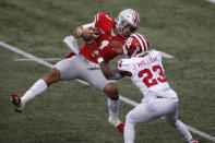 Indiana defensive back Jaylin Williams, right, knocks Ohio State quarterback Justin Fields to the ground during the first half of an NCAA college football game Saturday, Nov. 21, 2020, in Columbus, Ohio. (AP Photo/Jay LaPrete)