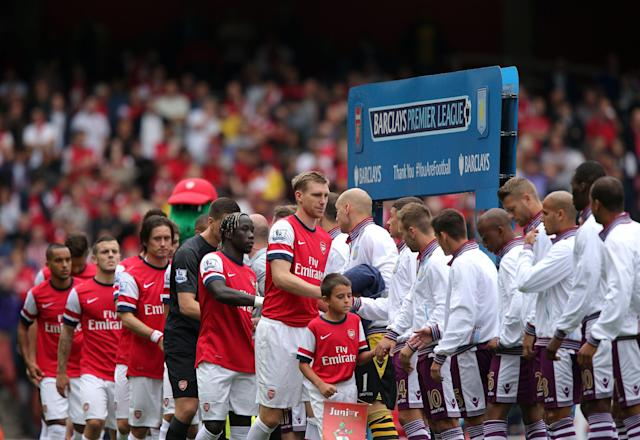 Arsenal's captain Per Mertesacker (centre) shakes hands with the Aston Villa players before the Barclays Premier League match the Emirates Stadium, London.