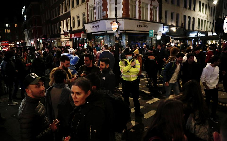 LONDON, UNITED KINGDOM - APRIL 12: People crowd the Soho area after restaurants and pubs, which were closed within the nationwide lockdown imposed to stem the spread of coronavirus (COVID-19), re-open in London, United Kingdom on April 12, 2021. Restaurants and pubs are made available to serve outdoors with the easing of COVID-19 measures. Easing of nationwide lockdown, imposed since January 5th, began. (Photo by Hasan Esen/Anadolu Agency via Getty Images)