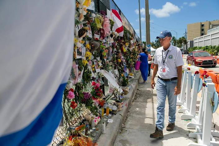 Surfside Mayor Charles Burkett visits the Surfside Wall of Hope & Memorial as rescue teams continue their recovery mission at the collapsed Champlain Towers South in Surfside, Florida, on Friday, July 16, 2021.