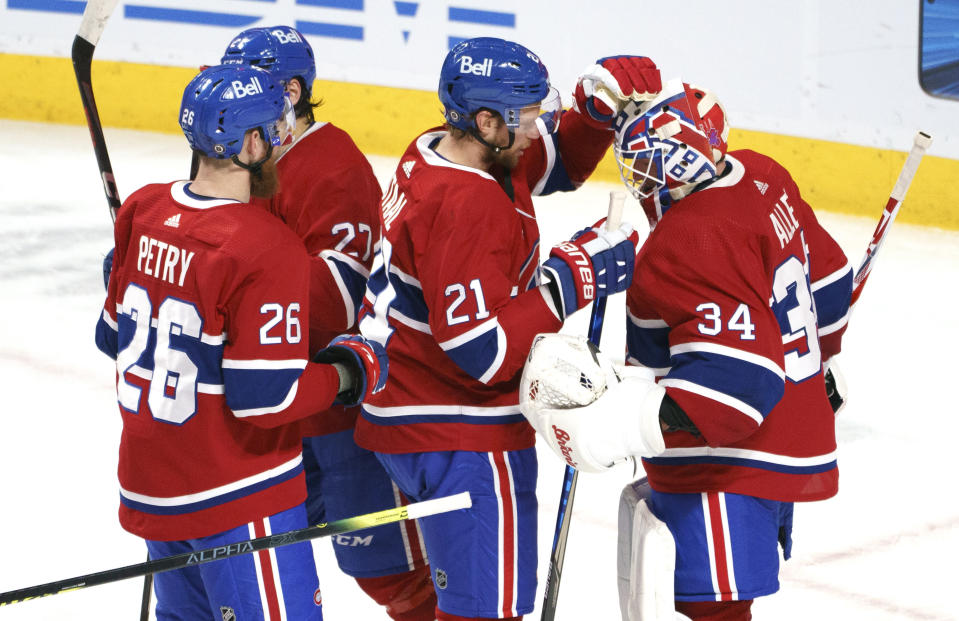 Montreal Canadiens' Jeff Petry, Eric Staal and Jake Allen, right, celebrate the team's victory over the Calgary Flames in an NHL hockey game Friday, April 16, 2021, in Montreal. (Paul Chiasson/The Canadian Press via AP)