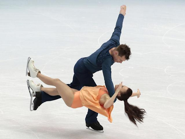Julia Zlobina and Alexei Sitnikov of Azerbaijan compete in the ice dance free dance figure skating finals at the Iceberg Skating Palace during the 2014 Winter Olympics, Monday, Feb. 17, 2014, in Sochi, Russia. (AP Photo/Ivan Sekretarev)