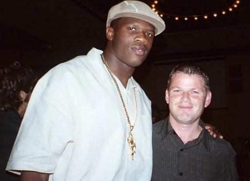 This photo of Andre Johnson and Nevin Shapiro was taken at Miami's team awards banquet following the 2002 season.