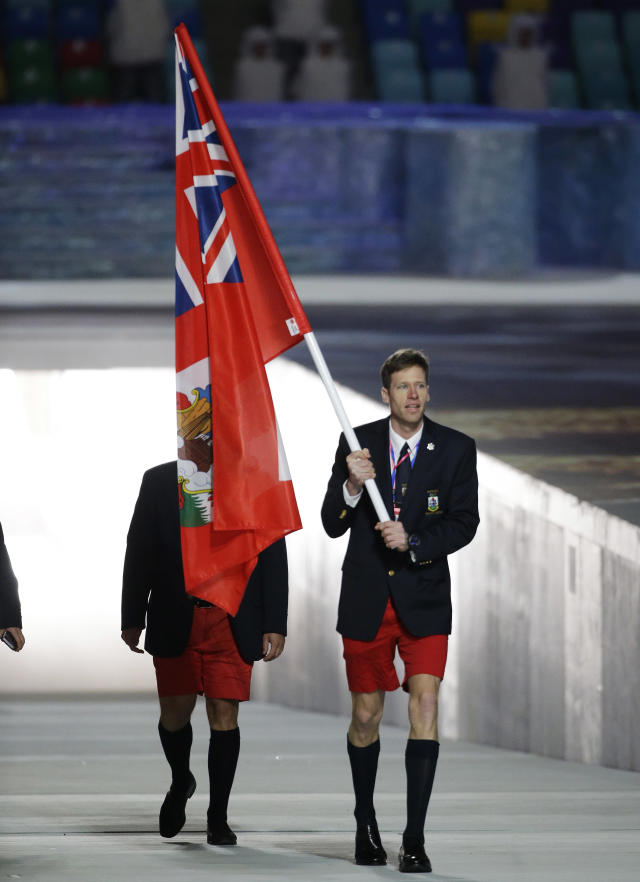 Tucker Murphy of Bermuda carries the national flag as he leads the team during the opening ceremony of the 2014 Winter Olympics in Sochi, Russia, Friday, Feb. 7, 2014. (AP Photo/Mark Humphrey)