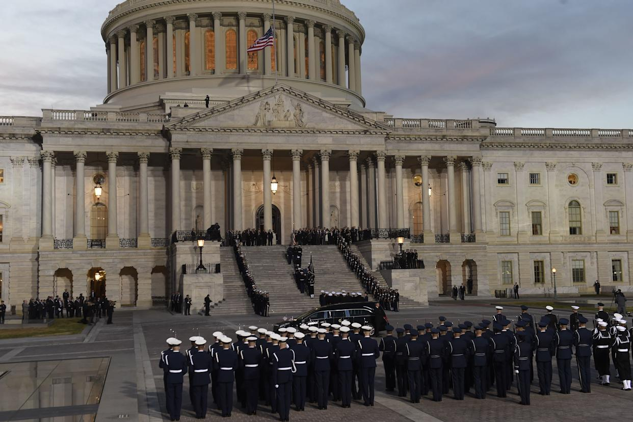 The casket bearing Bush's remains arrives at the Capitol.