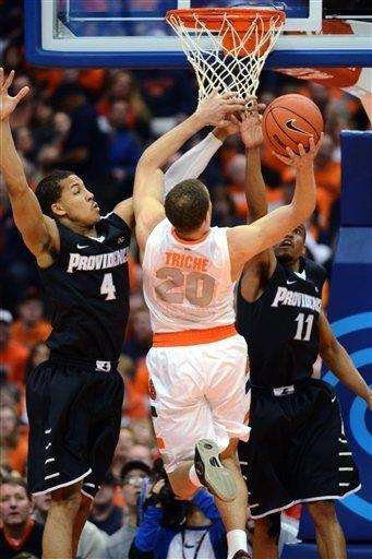 Providence's Josh Fortune (4) and Bryce Cotton 911) defend against Syracuse's Brandon Triche (20) during the first half in an NCAA college basketball game in Syracuse, N.Y., Wednesday, Feb. 20, 2013. (AP Photo/Kevin Rivoli)