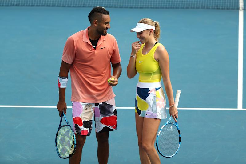 Nick Kyrgios and Amanda Anisimova laugh during their Mixed Doubles first round match.