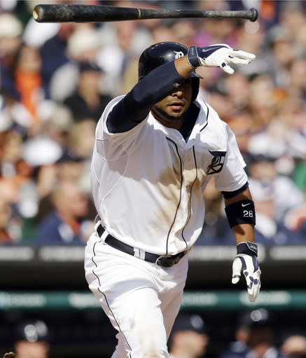 Detroit Tigers' Alex Gonzalez tosses his bat after lining a single driving in the winning run during the ninth inning of a baseball game against the Kansas City Royals in Detroit, Monday, March 31, 2014. (AP Photo/Carlos Osorio)