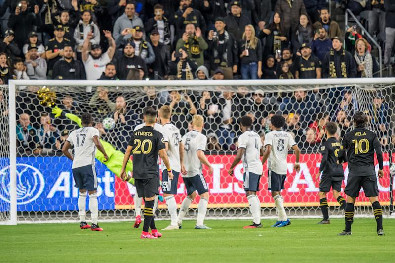 LOS ANGELES, CA - MARCH 8: Carlos Vela #10 of Los Angeles FC scores a free kick as Andre Blake #18 of Philadelphia Union tries to make a save during the MLS match at the Banc of California Stadium on March 8, 2020 in Los Angeles, California. The match ended in a 3-3 draw. (Photo by Shaun Clark/Getty Images)