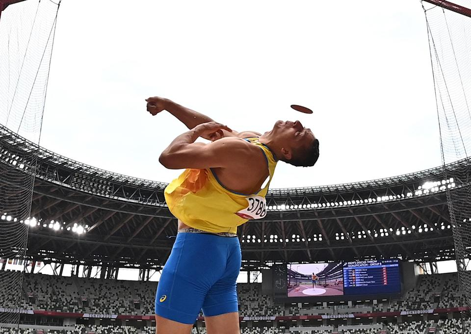 """<p>Ukraine's Mykyta Nesterenko competes in the men's discus throw qualification on July 30.</p> <p>Want more? <a href=""""https://people.com/sports/tokyo-olympics-best-photos-july-29-competitions/"""" rel=""""nofollow noopener"""" target=""""_blank"""" data-ylk=""""slk:See 15 Stunning Photos from Thursday's Competitions at the Tokyo Olympics."""" class=""""link rapid-noclick-resp"""">See 15 Stunning Photos from Thursday's Competitions at the Tokyo Olympics.</a></p>"""