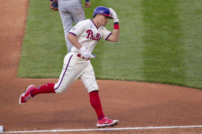 Philadelphia Phillies J.T. Realmuto (10) runs the bases after hitting a three run homer during the fifth inning of a baseball game against the New York Mets, Wednesday, April 7, 2021, in Philadelphia. (AP Photo/Laurence Kesterson)