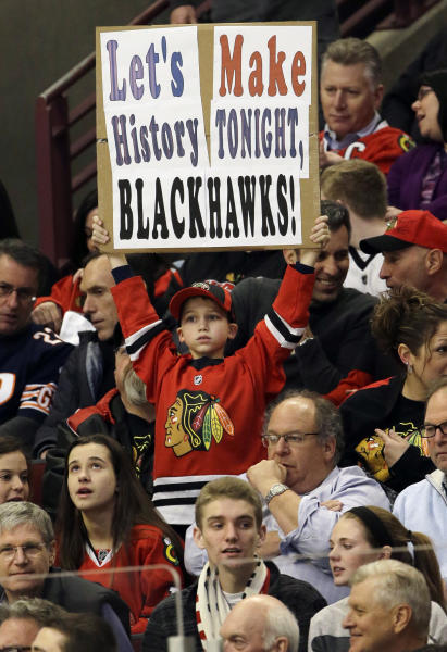 A Chicago Blackhawks fan holds a sign during the first period of an NHL hockey game between the Chicago Blackhawks and the San Jose Sharks in Chicago, Friday, Feb. 22, 2013. (AP Photo/Nam Y. Huh)