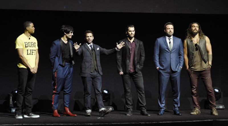 """Zack Snyder, center, director of the upcoming film """"Justice League,"""" addresses the audience with cast members, from left, Ray Fisher, Ezra Miller, Henry Cavill, Ben Affleck and Jason Momoa during the Warner Bros. Pictures presentation at CinemaCon 2017 at Caesars Palace on Wednesday, March 29, 2017, in Las Vegas. (Photo by Chris Pizzello/Invision/AP)"""
