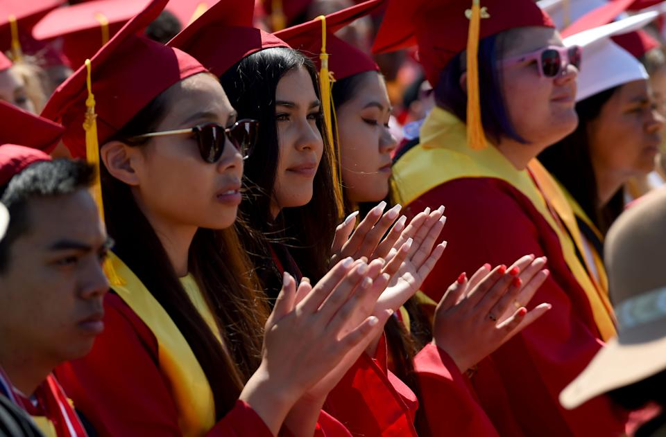 LONG BEACH, CA - JUNE 12: Lakewood High School students enjoy their graduation ceremony at Veterans Memorial Stadium in Long Beach on Wednesday, June 12, 2019. (Photo by Brittany Murray/MediaNews Group/Long Beach Press-Telegram via Getty Images)