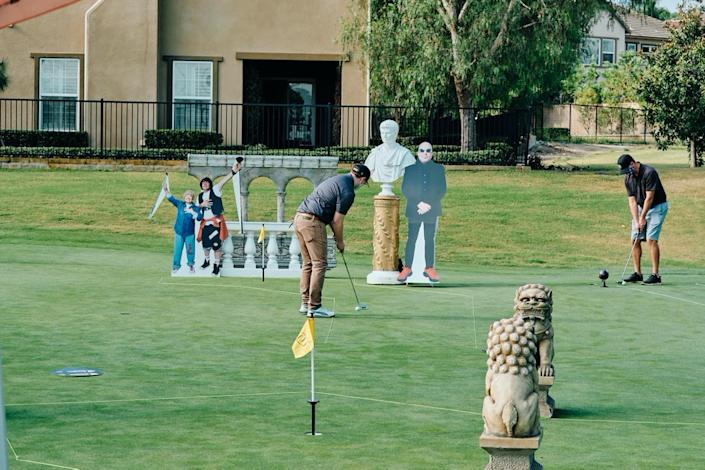 Golfers hit the putting contest geared up with masks.: Tilly's Golf Tournament Photo