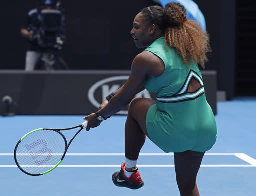 United States' Serena Williams reacts after hitting a backhand return during her first round match against Germany's Tatjana Maria at the Australian Open tennis championships in Melbourne, Australia, Tuesday, Jan. 15, 2019. (AP Photo/Kin Cheung)