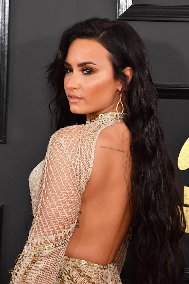 <p>In a backless dress, Demi gave a peek at some of her subtlest ink. (Photo: Getty Images) </p>