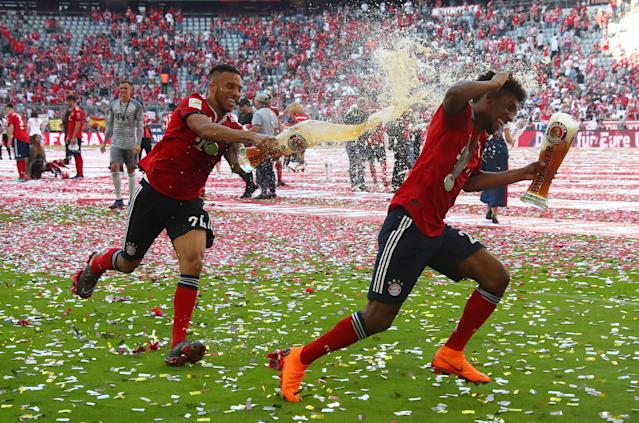 Soccer Football - Bundesliga - Bayern Munich v VfB Stuttgart - Allianz Arena, Munich, Germany - May 12, 2018 Bayern Munich's Corentin Tolisso and Kingsley Coman as they celebrate winning the Bundesliga REUTERS/Michael Dalder DFL RULES TO LIMIT THE ONLINE USAGE DURING MATCH TIME TO 15 PICTURES PER GAME. IMAGE SEQUENCES TO SIMULATE VIDEO IS NOT ALLOWED AT ANY TIME. FOR FURTHER QUERIES PLEASE CONTACT DFL DIRECTLY AT + 49 69 650050