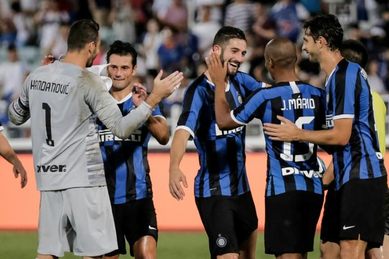 Inter Milan players celebrate their win against Paris Saint-Germain in a penalty shootout after their International Super Cup football match in Macau on July 27, 2019 (AFP Photo/VIVEK PRAKASH)