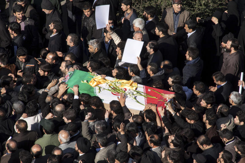 Iranian mourners carry the flag draped coffin of Gen. Hassan Shateri, during a funeral ceremony, in Tehran, Iran, Thursday, Feb. 14, 2013. Prominent Iranian politicians and clerics led mourners at a funeral Thursday for a senior commander of the country's powerful Revolutionary Guards who was killed this week while traveling from Syria to Lebanon, local media said. (AP Photo/Fars News Agency, Saeed Kariminejad)