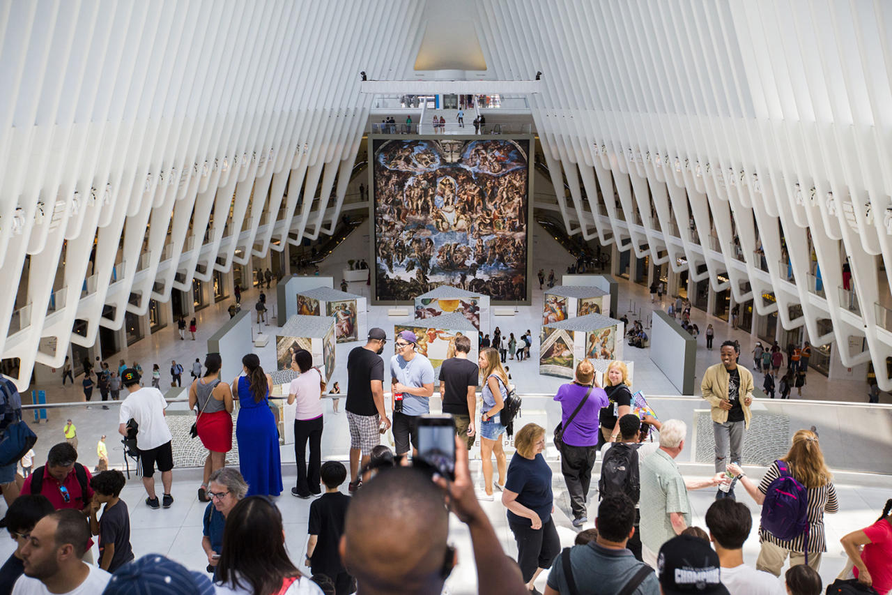 "<p>Passersby take photos of the 'Up Close: Michelangelo's Sistine Chapel' re-creation exhibit June 22, 2017, at the Oculus at Westfield World Trade Center in New York. The exhibit features 34 reproductions, including ""The Creation of Adam"" and ""The Last Judgement."" (AP Photo/Michael Noble Jr.) </p>"