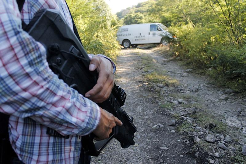 Mexican drug cartels often dump the bodies of their victims in mass graves, such as the one discovered here on the outskirts of Cocula, Guerrero state, Mexico on October 27, 2014