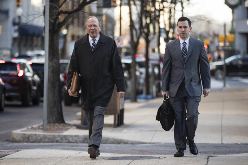 Chief Trial Deputy at Allegheny County District Attorney's Office Dan Fitzsimmons, left, and along with Assistant District Attorney Jonathan Fodi arrive for jury selection in former East Pittsburgh police officer Michael Rosfeld's trial who is accused of shooting to death a black teenager Antwon Rose II as he ran from a vehicle last year, at the Dauphin County Courthouse in Harrisburg, Pa., Tuesday, March 12, 2019. (AP Photo/Matt Rourke)