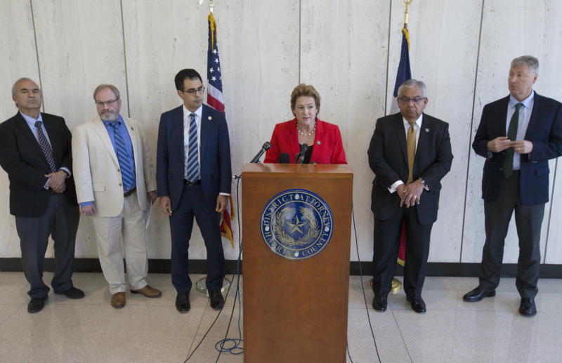 Harris County District Attorney Kim Ogg, center, announces that a grand jury decided to indict Arkema and Michael Keough, vice president of logistics division of the company, for reckless assault during a press conference on Wednesday, April 10, 2019, in Houston. Ogg said the trial will begin in May. (Yi-Chin Lee/Houston Chronicle via AP)
