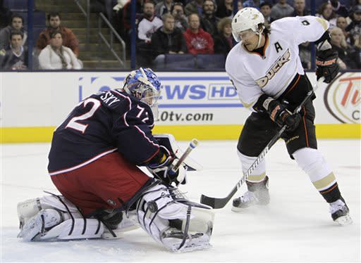 Columbus Blue Jackets' Sergei Bobrovsky, left, of Russia, makes a save against Anaheim Ducks' Teemu Selanne, of Finland, during the first period of an NHL hockey game Sunday Mar. 31, 2013, in Columbus, Ohio. (AP Photo/Jay LaPrete)
