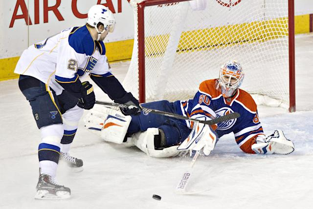 St. Louis Blues' Patrik Berglund (21) is stopped by Edmonton Oilers goalie Ilya Bryzgalov (80) during second period NHL hockey action in Edmonton, Canada, Tuesday, Jan. 7, 2014. (AP Photo/The Canadian Press, Jason Franson)