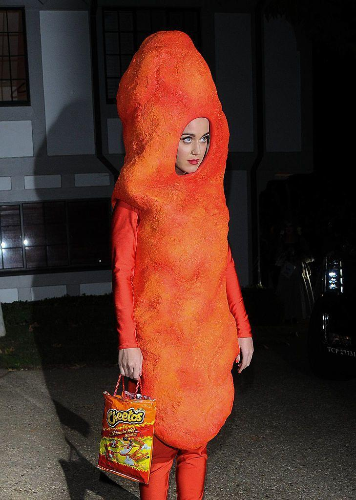 <p>The singer and <em>American Idol</em> host is known for her over-the-top costumes. In 2014, she perfected the Cheeto look.</p>