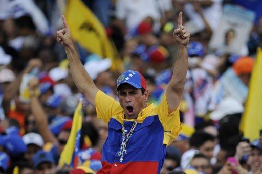 Venezuelan opposition presidential candidate Henrique Capriles arrives to a campaign rally in Caracas, on September 30. Hundreds of thousands of backers of Capriles thronged the streets of the Venezuelan capital, echoing his rising threat to President Hugo Chavez's reelection