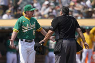 Oakland Athletics manager Bob Melvin, left, reacts after being thrown out by umpire Tony Randazzo, right, during the third inning of a baseball game against the New York Yankees in Oakland, Calif., Saturday, Aug. 28, 2021. (AP Photo/Jeff Chiu)