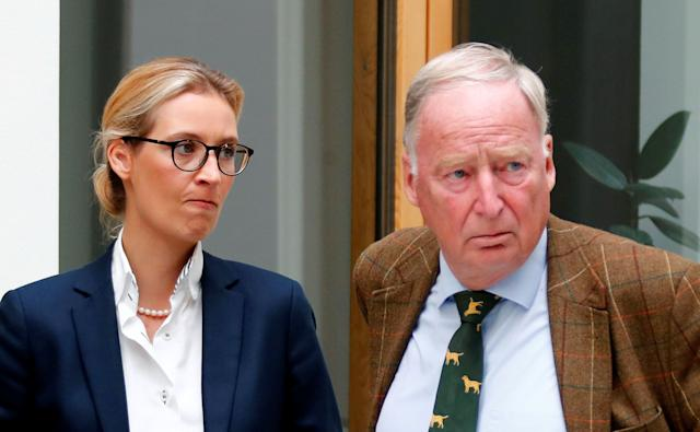 Alice Weidel (L) and Alexander Gauland of the anti-immigration party Alternative for Germany (AFD) react before they address a news conference in Berlin, Germany August 21, 2017.