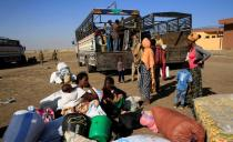 FILE PHOTO: Ethiopians who fled the ongoing fighting in Tigray region, prepare to board a courtesy trucks in Hamdayet village on the Sudan-Ethiopia border, eastern Kassala state