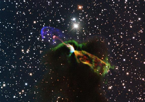 This image of Herbig-Haro object HH 46/47 combines radio observations acquired with the Atacama Large Millimeter/submillimeter Array (ALMA) with much shorter wavelength visible light observations from ESO's New Technology Telescope (NTT). The A