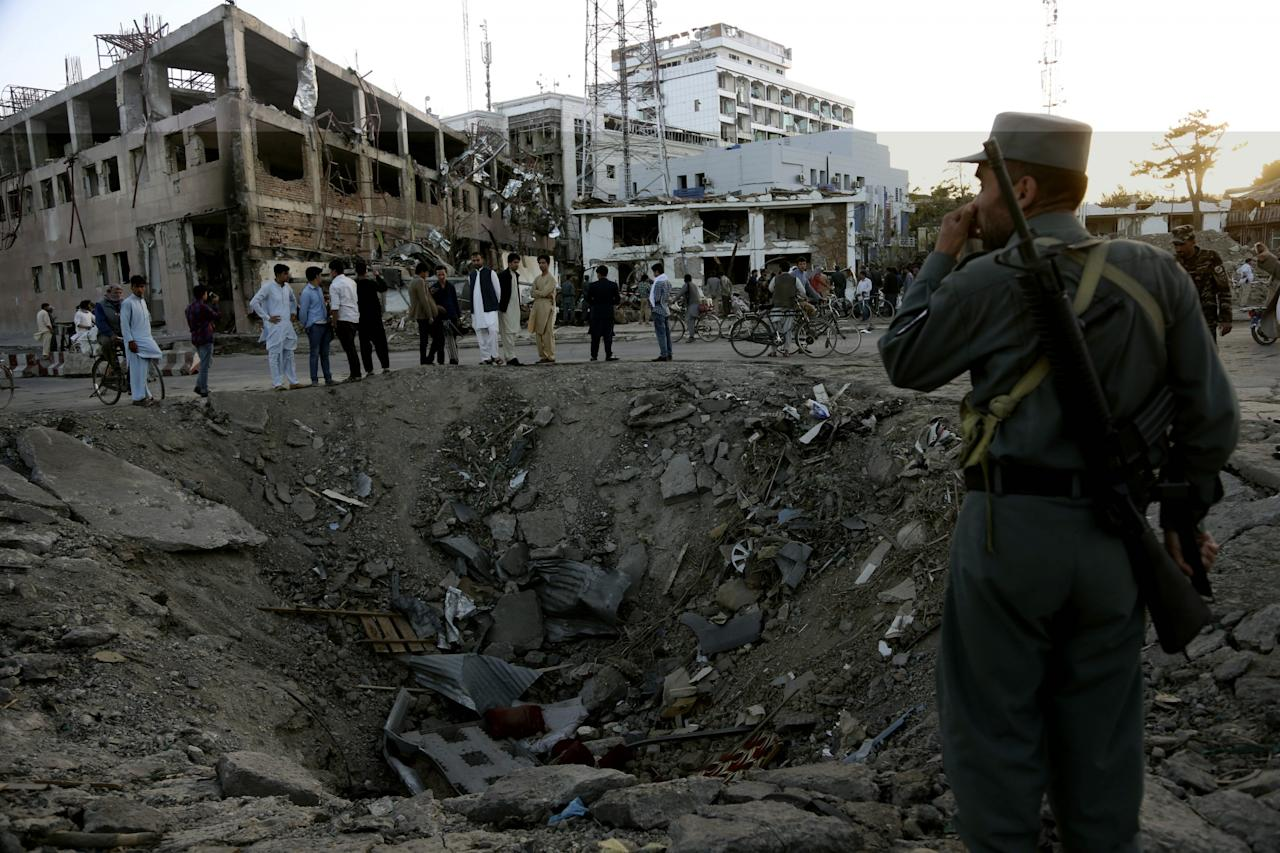 <p>Security forces stand next to a crater created by massive explosion in front of the German Embassy in Kabul, Afghanistan, Wednesday, May 31, 2017. (AP Photo/Rahmat Gul) </p>