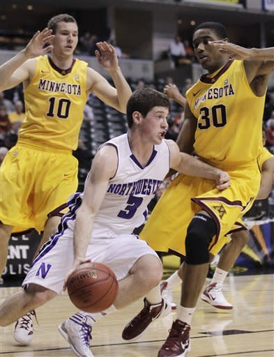Northwestern guard Dave Sobolewski (3) drives around Minnesota forwards Oto Osenieks (10) and Andre Ingram (30) in the first half of an NCAA college basketball game at the first round of the Big Ten Conference tournament in Indianapolis, Thursday, March 8, 2012. (AP Photo/Michael Conroy)