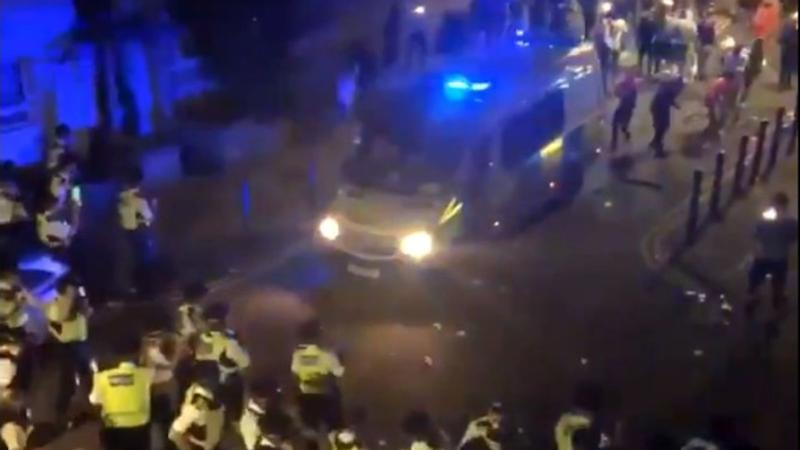 Bottles and other objects thrown at police in Brixton