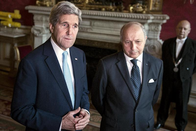 French Foreign Affairs Minister Laurent Fabius (R) and US Secretary of State John Kerry make statements to the press after their meeting at the Foreign Affairs Ministry in Paris, on June 26, 2014