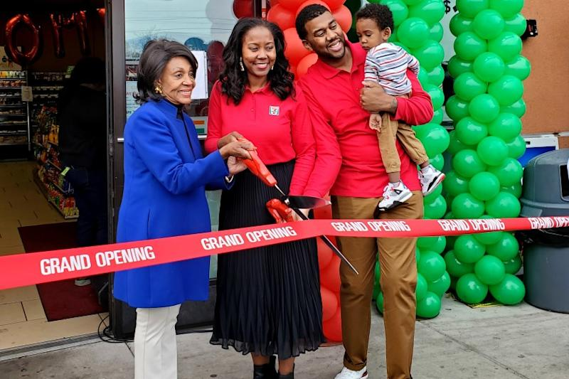 Chanda Simon-Thomas and husband Kenji Thomas cut the ribbon for the opening of their 7-Eleven store with Rep. Maxine Waters (D-Los Angeles) in November 2019. (Photo by: Paula Barrow)