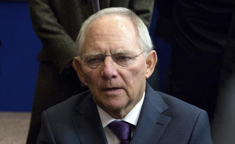 Germany's Finance Minister Schaeuble talks to the media as he arrives at an Eurozone finance ministers meeting in Brussels